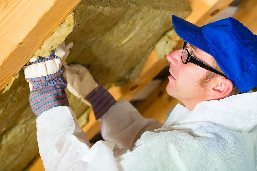 man installing insulation foam